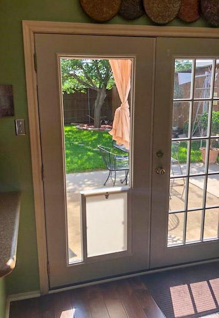 pet door inside french door glass